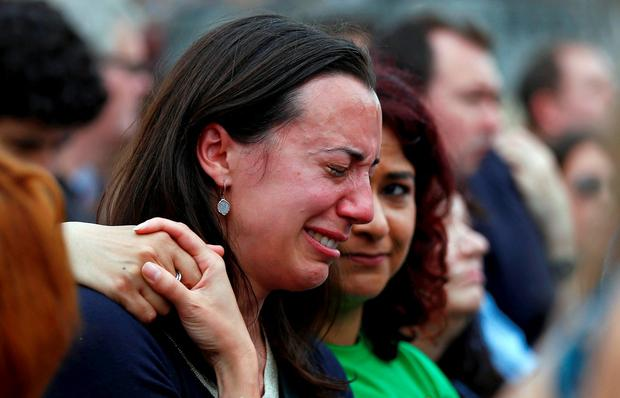 A woman reacts during a special service for murdered Labour Party MP Jo Cox, at Trafalgar Square in London, Britain June 22, 2016