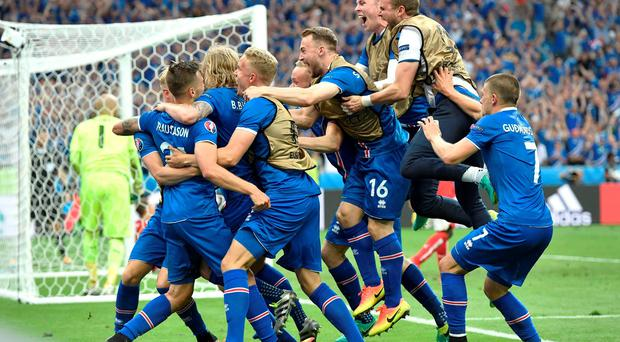 Iceland players celebrate a goal by Iceland's Arnor Ingvi Traustason during the Euro 2016 Group F soccer match between Iceland and Austria