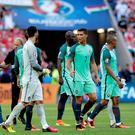 Portugal's Cristiano Ronaldo, center left, and his teammates leave the pitch