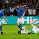 Daryl Murphy in action with Italy's Thiago Motta and Stefano Sturaro