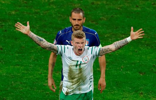 Republic of Ireland's James McClean gestures towards referee Ovidiu Hategan after being challenged by Italy's Federico Bernardeschi in the penalty area during Euro 2016