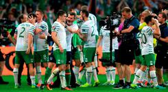 Ireland's Robbie Brady (left) is congratulated by assistant manager Roy Keane on the pitch after beating Italy