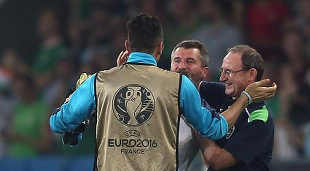 LILLE, FRANCE - JUNE 22: Republic of Ireland manager Martin O'Neill celebrates at full-time with assistant coach Roy Keane as Gianluigi Buffon of Italy congratulates them following the UEFA Euro 2016 Group E match between Italy and Republic of Ireland at Stade Pierre-Mauroy on June 22, 2016 in Lille, France. (Photo by Chris Brunskill Ltd/Getty Images)