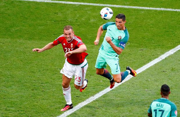 Portugal's Cristiano Ronaldo scores their third goal