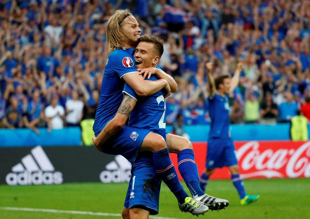 Iceland's Arnor Ingvi Traustason celebrates with Birkir Bjarnason after scoring the second goal. Photo: Darren Staples/Reuters