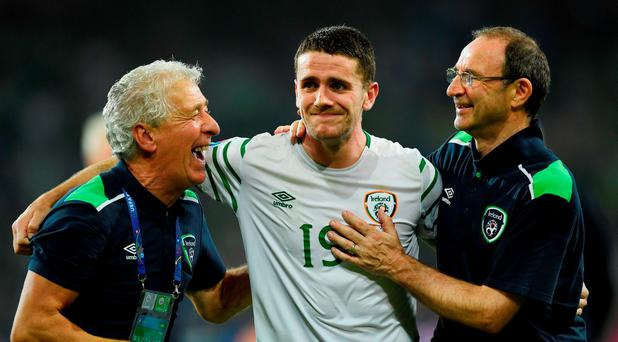 An emotional Robbie Brady is congratulated by Martin O'Neill (R) manager of Republic of Ireland after win over Italy at Euro 2016