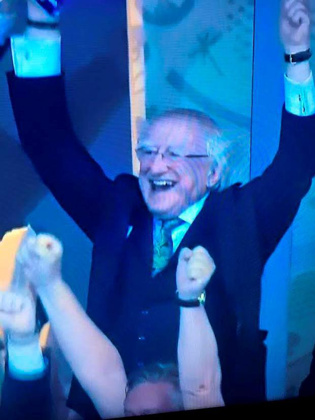 Michael D Higgins celebrating