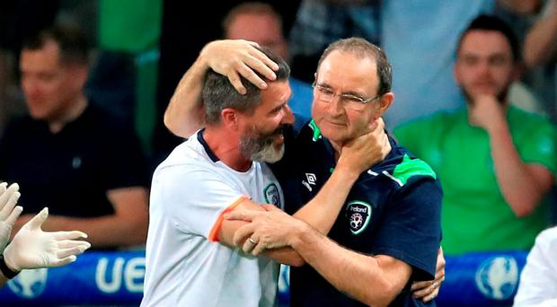 Ireland manager Martin O'Neill (right) and assistant Roy Keane celebrate qualifying for the round of 16