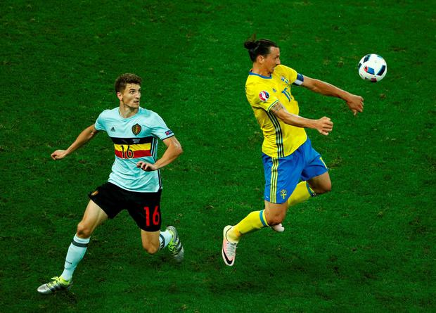 Sweden's Zlatan Ibrahimovic in action with Belgium's Thomas Meunier. Photo: Eddie Keogh/Reuters
