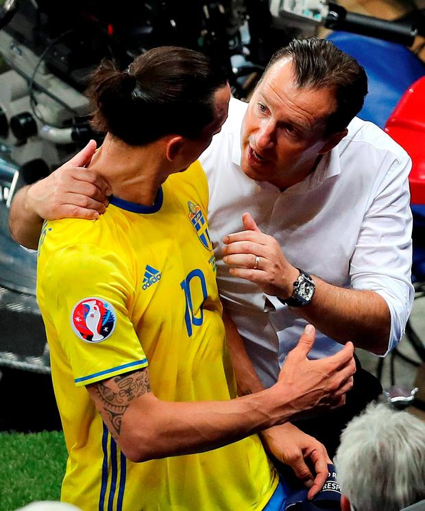 Sweden's Zlatan Ibrahimovic is greeted by Belgium coach Marc Wilmots as he leaves the field