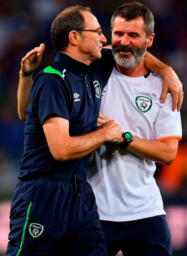 Martin O'Neill embraces Roy Keane after the game. Photo: Stephen McCarthy / Sportsfile