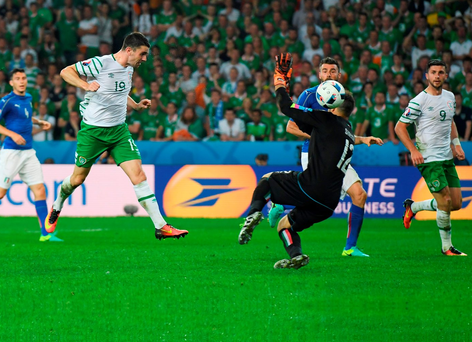 Ireland's Robbie Brady heads past Salvatore Sirigu for the only goal of the game against Italy in the Group E qualifier in Lille last night. Photo: Matthias Hangst/Getty Images