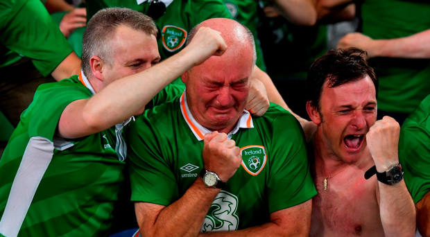 Ireland supporters celebrate following the win over Italy