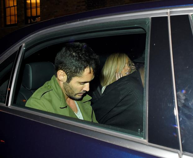 Jean-Bernard Fernandez-Versini leaves The Chiltern Firehouse with Nicola Hughes, who was trying to hide from the cameras! Jean-Bernard exited first closely followed by Nicola who was getting some help hiding her face by a member of The Chiltern staff. Photo: Vantagenews.com