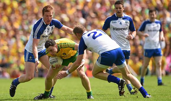 Martin McElhinney, Donegal, in action against Kieran Duffy, left, and Owen Lennon, Monaghan. Ulster GAA Football Senior Championship Final, Donegal v Monaghan