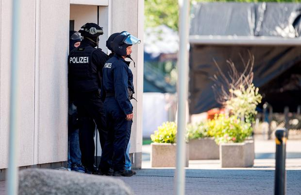 Heavily-armed police outside a movie theatre complex where an armed man has reportedly opened fire on June 23, 2016 in Viernheim, Germany. According to initial media reports, the man entered the cinema today at approximately 3pm, fired a shot in the air and barricaded himself inside. (Photo by Alexander Scheuber/Getty Images)