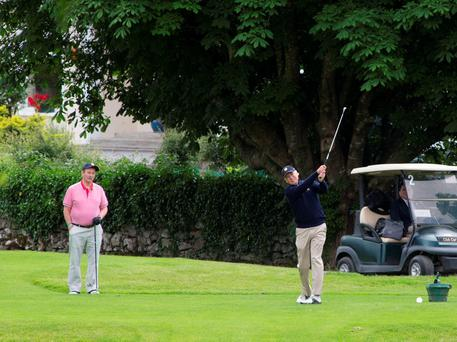 US Vice President Joe Biden teeing off on the seventeenth at The Castlebar Golf Club as Taoiseach Enda Kenny watches yesterday. Pic Colin O Riordan