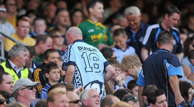 A Dublin fan leaves before the end of Meath's victory over Pat Gilroy's side in 2010