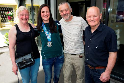 Kellie Harrington at St Vincent's with her mum Yvonne, dad Christy and coach Jimmy Halpin (right). Photo: Douglas O'Connor
