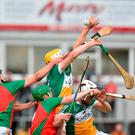 Oisin Kelly and Emmet Nolan of Offaly in action against Michael Malone and Paraic Coughlan of Carlow during the Bord Gáis Energy Leinster GAA Hurling U21 Championship Semi-Final match between Carlow and Offaly at Netwatch Cullen Park in Carlow. Photo by Matt Browne/Sportsfile