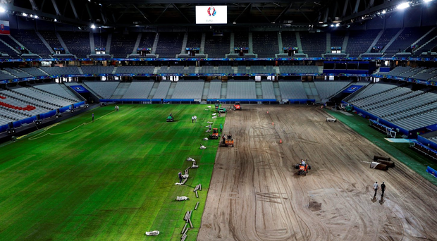 Workers laying the new pitch in Lille yesterday. Photo: AP Photo/Frank Augstein