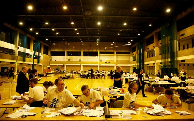 Workers begin counting ballots after polling stations closed in the Referendum on the European Union in Islington, London, Britain, June 23, 2016. REUTERS/Neil Hall