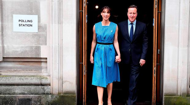 British Prime Minister David Cameron and his wife Samantha leave after casting their votes in the EU referendum, at a polling station in London. Photo: Getty