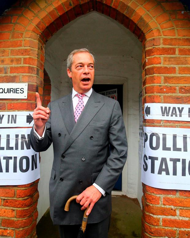 Ukip leader Nigel Farage arrives to cast his vote. Photo: PA