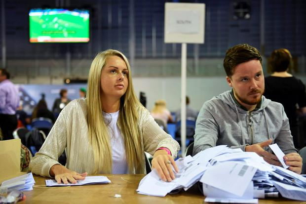 Workers begin counting ballots after polling stations closed in the Referendum on the European Union in Glasgow, Scotland, Britain, June 23, 2016. REUTERS/Clodagh Kilcoyne