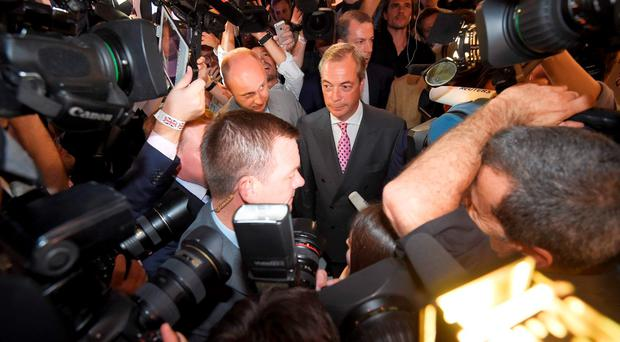 Nigel Farage, the leader of the United Kingdom Independence Party (UKIP), addresses supporters at a A Leave.eu party after polling stations closed in the Referendum on the European Union in London, Britain, June 23, 2016. REUTERS/Toby Melville