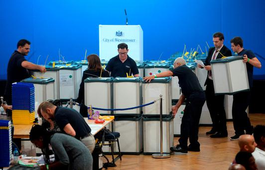Staff manhandle ballot boxes at the Lindley Hall, Royal Horticultural Halls, London, where votes from the City of Westminster and City of London are being counted after the polls closed in the EU referendum. Anthony Devlin/PA Wire