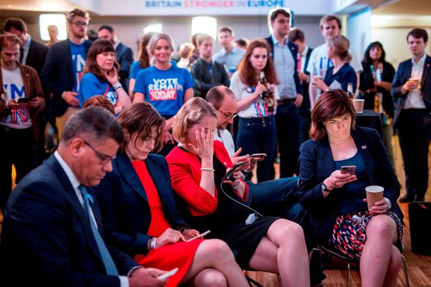Supporters of the Stronger In campaign react after hearing results in the EU referendum at London's Royal Festival Hall. Rob Stothard/PA Wire