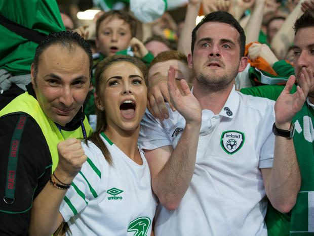 Republic of Ireland Robbie Brady's girlfriend Kerrie Harris (left) and brother (centre) show their emotions at full time of the UEFA Euro 2016 Group E match between Italy and Republic of Ireland at Stade Pierre-Mauroy on June 22 in Lille, France. (Photo by Craig Mercer/CameraSport via Getty Images)