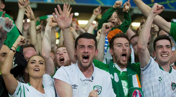 Robbie Brady's girlfriend Kerrie Harris (left) and brother (centre) show their emotions at full time against Italy