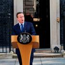 Prime Minister David Cameron speaks outside 10 Downing Street, London, with wife Samantha where he announced his resignation: Daniel Leal-Olivas/PA Wire