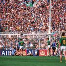 Meath's Kevin Foley scores late in the game as Dublin supporters on Hill 16 look on. Leinster Senior Football Championship, First Round, Third Replay, Dublin v Meath, Croke Park, Dublin in 1991. Picture credit: SPORTSFILE