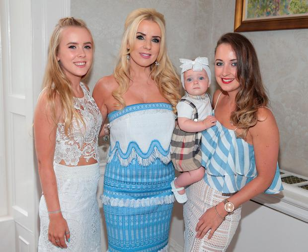 Roz Flanagan with daughters Montiquea and Melissa and granddaughter India at The annual Cari Charity Summer lunch at The Shelbourne Hotel,Dublin. Pictures :Brian McEvoy