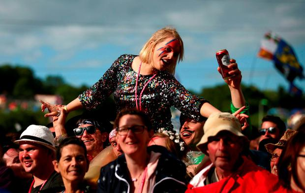 Fans in the crowd enjoying ZZ Top on the Pyramid Stage at the Glastonbury Festival, at Worthy Farm in Somerset Credit: Yui Mok/PA Wire