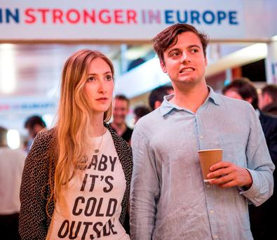 Supporters of the Stronger In Campaign react as results of the EU referendum are announced at the Royal Festival Hall. (Photo by Rob Stothard/Getty Images)