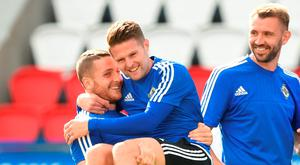 Conor Washington (left) and Oliver Norwood in playful mood during Northertn Ireland's training session at the Parc de Princes yesterday. Photo: PA