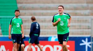 Robbie Brady in relaxed mood during yesterday's training session in Versailles. Photo: PA