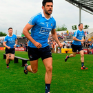 Cian O'Sullivan runs out on the pitch at Nowlan Park. Pics: Sportsfile