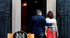 Prime Minister David Cameron walks into 10 Downing Street with wife Samantha after he announced his resignation. Photo: Daniel Leal-Olivas/PA Wire