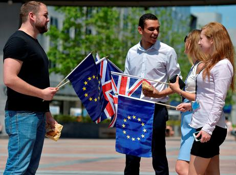 British students hold the Union Jack and European Union flags in front of the European Parliament in Brussels yesterday. Photo: Reuters