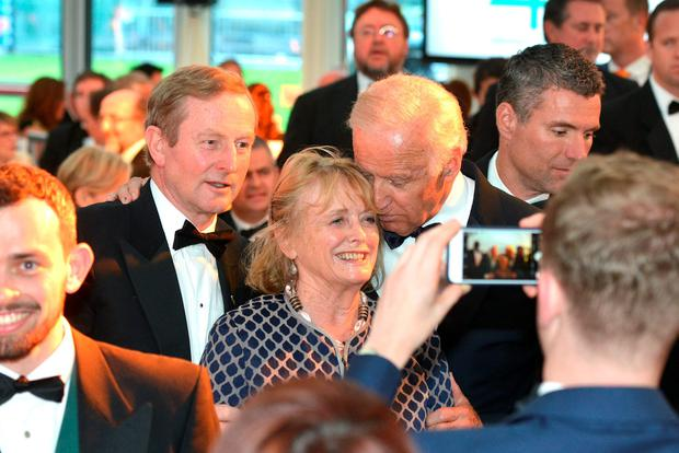 US Vice President Joe Biden hugs Seamus Heaney's wife, Marie as they have their photo taken with Taoiseach Enda Kenny during the Ireland Fund's 40th Anniversary Gala Dinner at Trinity College Credit: Barbara Lindberg.