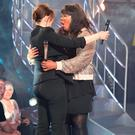 Natalie Rowe hugs presenter Emma Willis as she is evicted from the Big Brother house at the Elstree Studios, London. Credit: Ian West/PA Wire