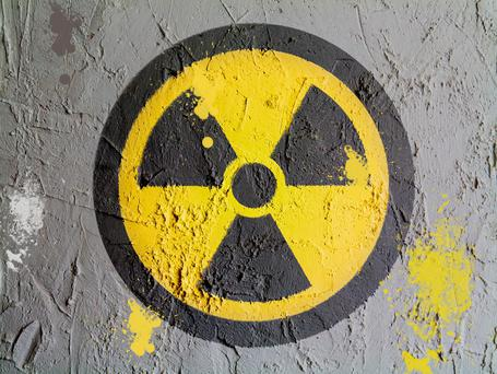 A video released by Moldovan authorities showed masked officers wrestling a man to the ground and using a Geiger counter to check radiation on a small package in his car. Stock photo: Depositphotos