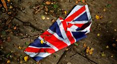 A British flag which was washed away by heavy rains the day before lies on the street in London, Britain, June 24, 2016 after Britain voted to leave the European Union in the EU BREXIT referendum. REUTERS/Reinhard Krause