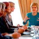 First Minister Nicola Sturgeon (right) speaks during an emergency cabinet meeting at Bute House on June 25, 2016 in Edinburgh.