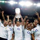 England Captain Dylan Hartley holds aloft the Australia-England test series trophy after winning their third game against Australia